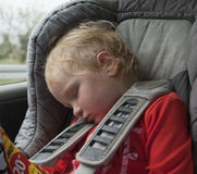 Tired sleeping child in car Stock Photo