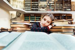 Girl with Books in the Library stock image