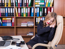 Tired sleeping woman in office Stock Images