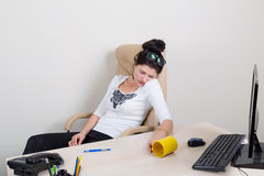 Tired sleeping woman in office Stock Photo