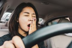 Free Tired Sleepy Asian Woman Yawning During Driving Car Stock Images - 163821484