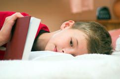 Tired and sleepy but still studying. Young boy is tired, but must studying Royalty Free Stock Photo