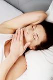 Tired sleepy woman waking up. royalty free stock image