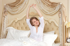Tired sleepy woman waking up Royalty Free Stock Photos
