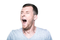 Tired sleepy young man yawning Royalty Free Stock Photography