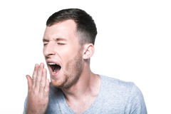 Tired sleepy young man yawning Royalty Free Stock Photo