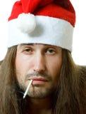 Tired smoking santa Royalty Free Stock Photos