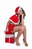 Tired snow maiden sits on the gift Royalty Free Stock Photos