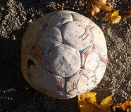 Tired Soccer ball. Wornout soccerball stock photo