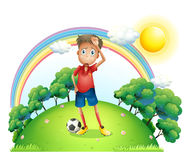 A tired soccer player at the top of the hill Royalty Free Stock Image