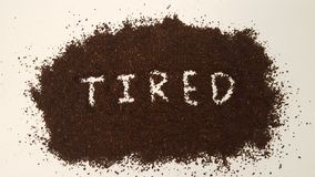Tired Spelled Out in Ground Coffee royalty free stock photos