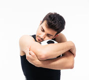 Tired sports man hugging soccer ball Royalty Free Stock Images