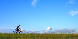 Tired sportsman against The Blue Sky Stock Images