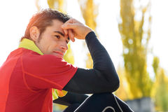 Tired sportsman resting and meditating Royalty Free Stock Photos