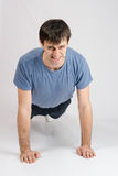 Tired sportsman wrung from the floor Royalty Free Stock Images