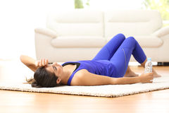 Tired sportswoman at home after sport Royalty Free Stock Photography