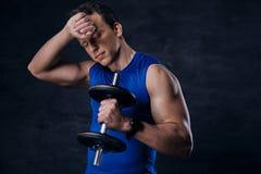 Sporty male in a blue sportswear after hard workout. Tired sporty male in a blue sportswear after hard workout Stock Image
