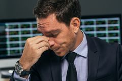 Tired stock market trader Royalty Free Stock Image
