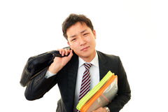 Tired and stressed Asian businessman Stock Photography