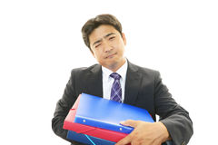 Tired and stressed Asian businessman Royalty Free Stock Images