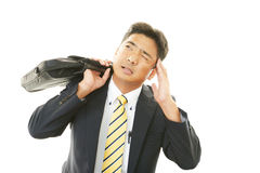 Tired and stressed Asian businessman Stock Image