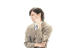 Tired and stressed Asian businessman Stock Photo