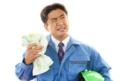 Tired and stressed Asian worker Royalty Free Stock Images