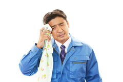 Tired and stressed Asian worker Stock Photos