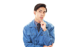 Tired and stressed Asian worker Stock Photo