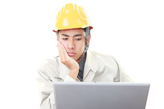 Tired and stressed Asian worker. Portrait of a worker isolated on white Royalty Free Stock Image