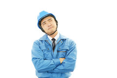 Tired and stressed Asian worker. An asian worker on white back ground Stock Photos