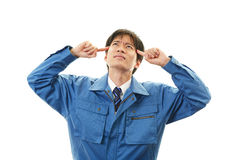 Tired and stressed Asian worker Stock Photography