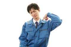 Tired and stressed Asian worker. An asian worker on white back ground Stock Photography