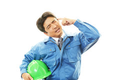 Tired and stressed Asian worker. An asian worker on white back ground Royalty Free Stock Photography
