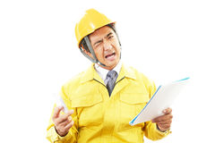 Tired and stressed Asian worker. An asian worker on white back ground Royalty Free Stock Photos