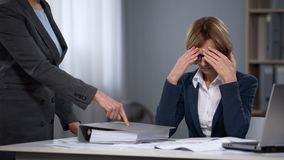 Tired stressed executive office worker feeling boss pressure, overtime work. Stock photo stock images
