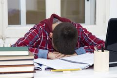 Tired and stressed at the school. Child tired and stressed at the school desk Stock Photo