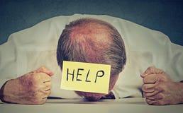 Tired, stressed senior employee needs help Stock Images