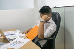 Tired and stressful man overloaded with business work royalty free stock photography
