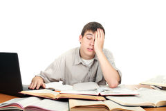 Tired student. Bored and tired student after hard work. isolated on the white background Royalty Free Stock Photography