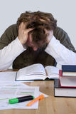 Tired student. Studying and reading books Royalty Free Stock Photos