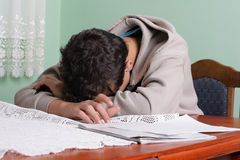 Tired Student Asleep at Desk. Tired young boy asleep at his desk Royalty Free Stock Images