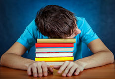 Tired Student with a Books Royalty Free Stock Photos