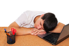 Tired student boy sleeping on the table Stock Image