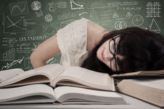 Tired student at classroom Royalty Free Stock Images