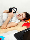 Tired Student with the Clock Royalty Free Stock Photography