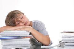 Tired student at the desk Royalty Free Stock Image