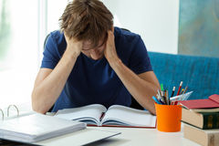 Tired student doesn't want to learn Royalty Free Stock Image