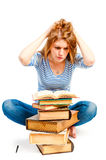 Tired student engaged in reading literature Royalty Free Stock Photos