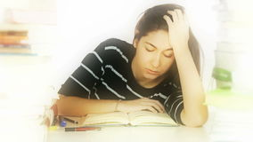 Tired student falling asleep Stock Photos